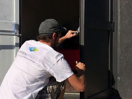 Painter painting door edge