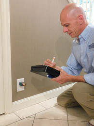 Inspecting-Electrical-Outlet