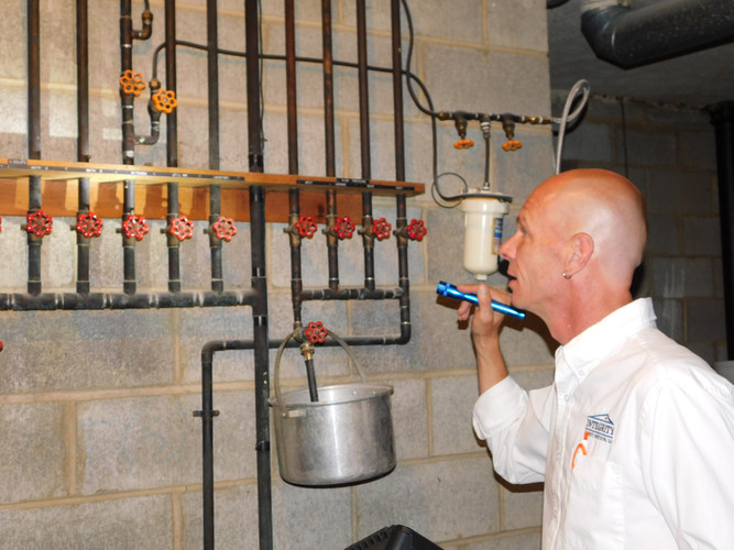 inspecting-plumbing.JPG