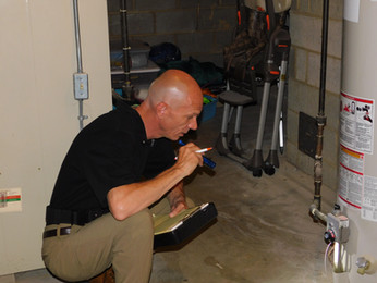 inspecting-water-heater.JPG
