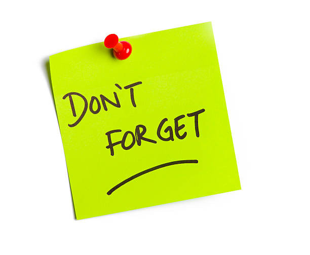 a green post it note that says 'don't forget' pinned with a red needle