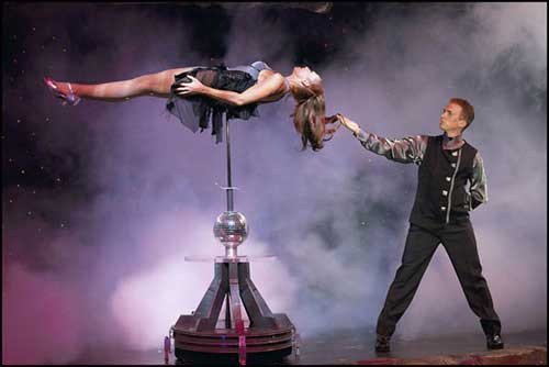 an illusion act performing on stage