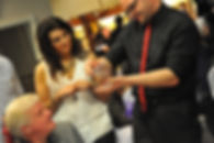 Entertainer performs close up magic using cards at an event