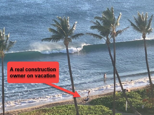 Owner of construction company on vacation checking emails