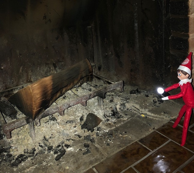 Inspector Elfie makes sure the chimney is ready for Santa