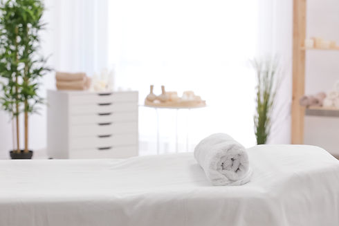 Towel on massage table in modern spa sal