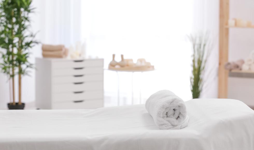 Towel on massage table in modern spa salon.jpg