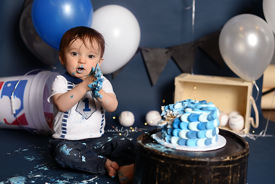 Jacob's turning one. Baseball cake smash session.