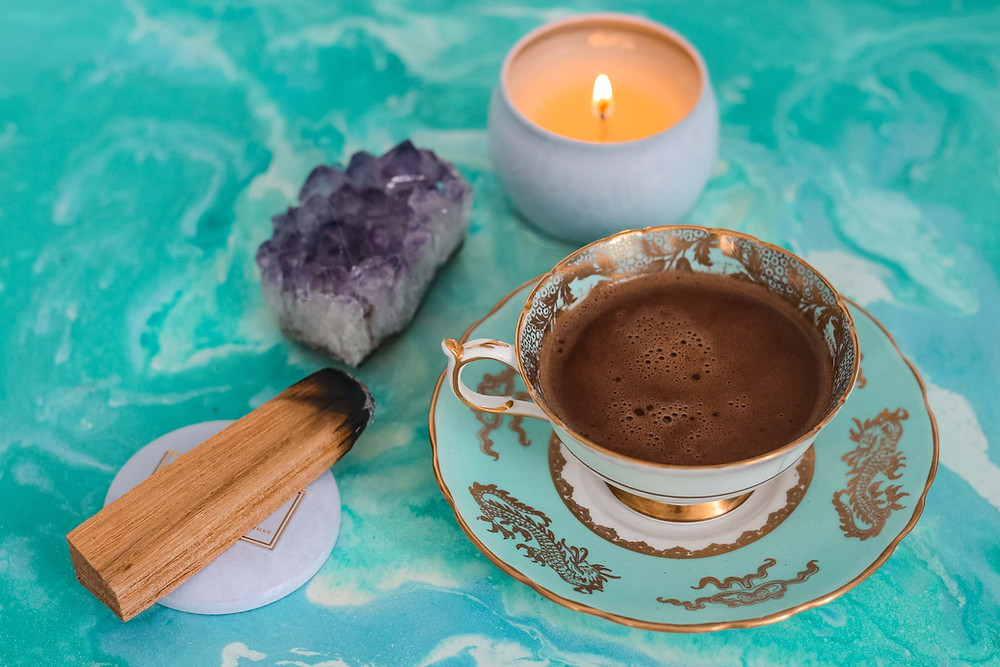 the happy healing shop crystals for protection coffee palo santo candle amethyst on table
