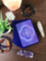 tarot spread with sage, plant, crystal quartz background