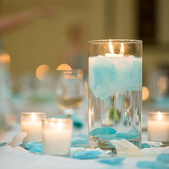 candles in vases event decor