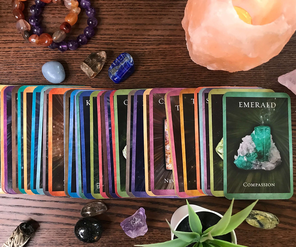 oracle cards compassion green crystal with candle