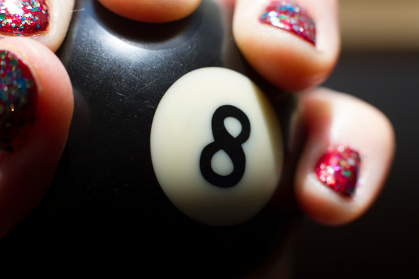 Hand with sparkly nail polish holding 8 Ball.JPG