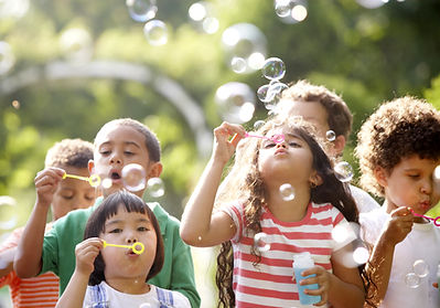 Youth and Family Counseling Agency of Oyster Bay campers blowing bubbles
