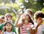 Bambini Blowing Bubbles