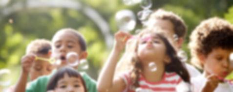children blowing bubbles in sunday school