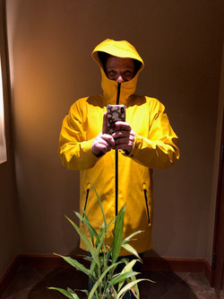 Alex Hensley in Seattle with the brightest yellow raincoat zipped up to their nose