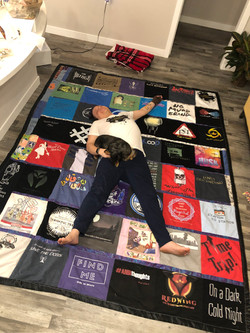 Alex sprawled out on quilt
