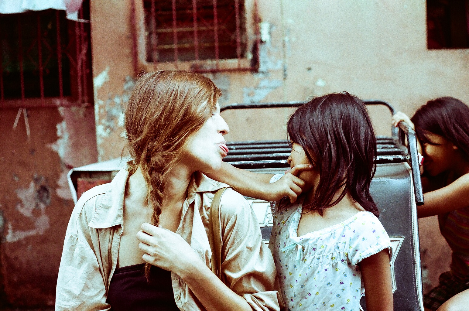 Marthe Olsen making faces with a little girl