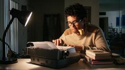 Writer working on a typewriter