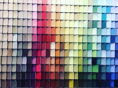 bright-colorful-paint-swatches-on-the-wa