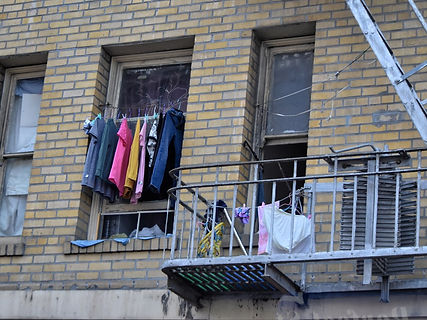 laundry-hanging-from-the-window-next-to-