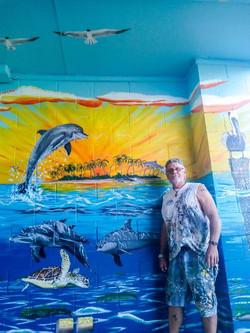 Photo of daniel in front of mural