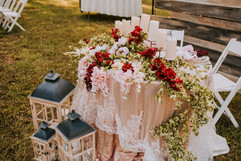 Beautiful floral arrangement of the bride and groom table