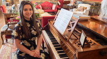 Lara with the Pleyel piano Chopin played and composed on in his Paris apartment