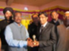 Dr. Akash Prasad receiving award