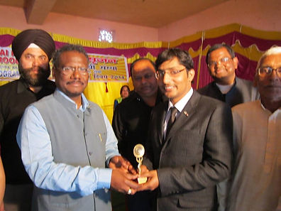 Dr. Akash Prasad receiving award