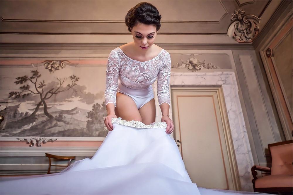 abito da sposa in pizzo realizzato a mano da Andreia  Cruz