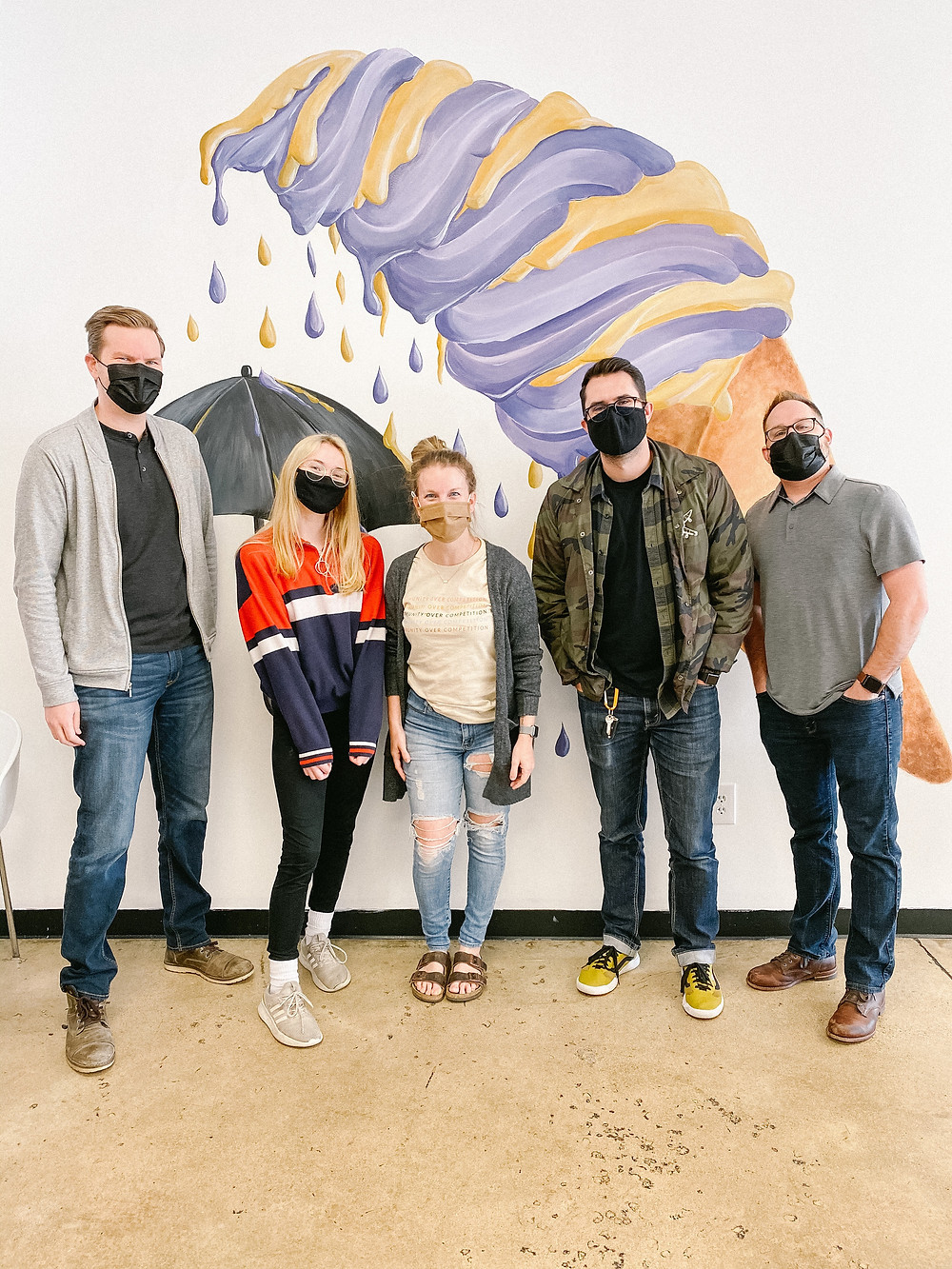 The Storytellers Studios team standing in front of ice cream mural at The Salted Lemon