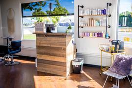 Rustic wood front desk wolf and Sparrow Salon La Mesa, Ca