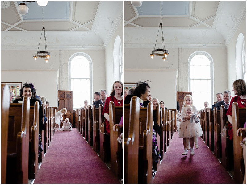 Cute flower girls walking down the aisle.