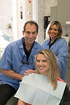 Picture of a patient, Dr. Weitman and Assistant