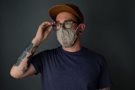 man-wearing-mask-adjusting-his-glasses.j