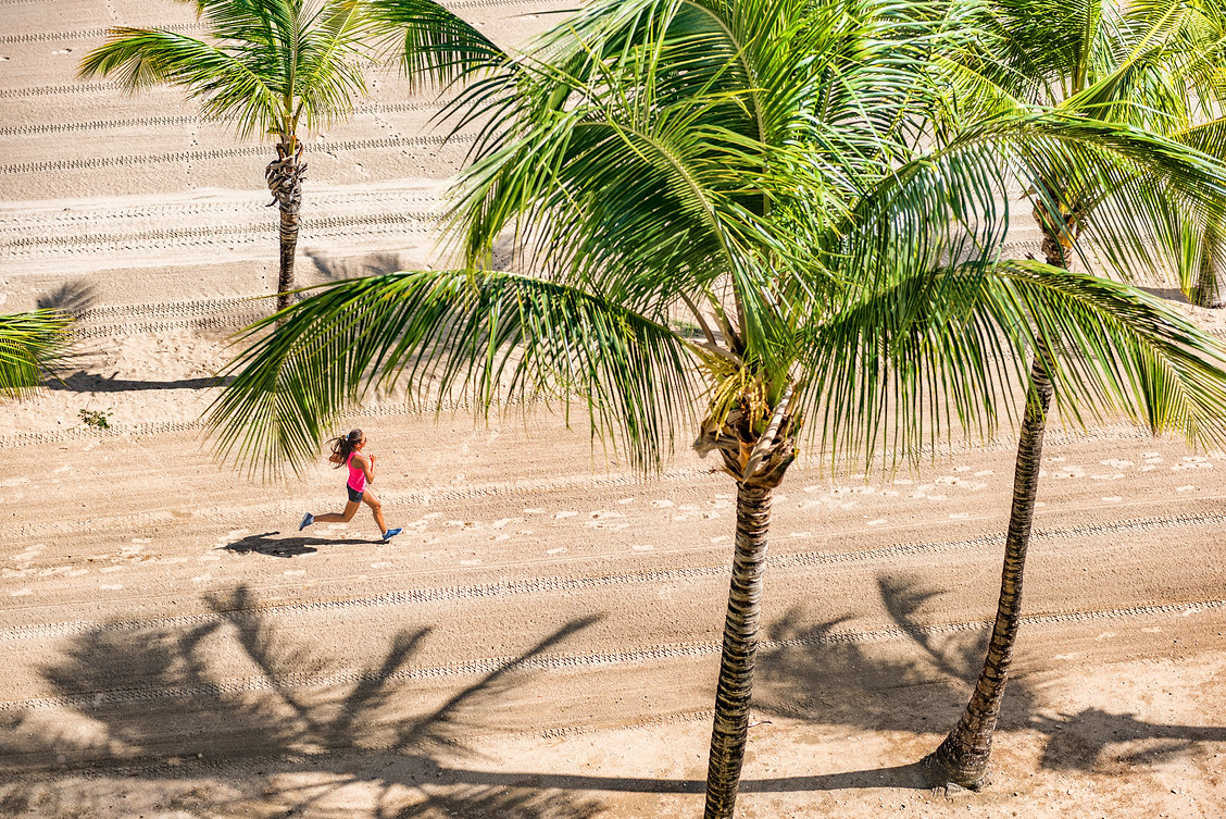 Runner on beach in Palm Trees Ahead   Coconut Workouts