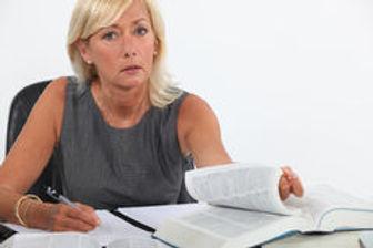 female-lawyer-studying-exam-33939690.jpg