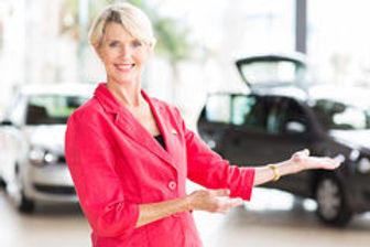 middle-aged-saleswoman-pretty-welcoming-