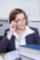 business-woman-looking-over-rim-her-glas