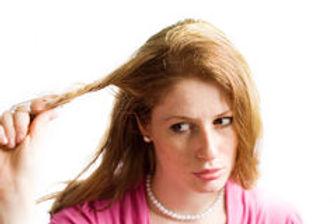 girl-pulling-her-hair-15180849.jpg