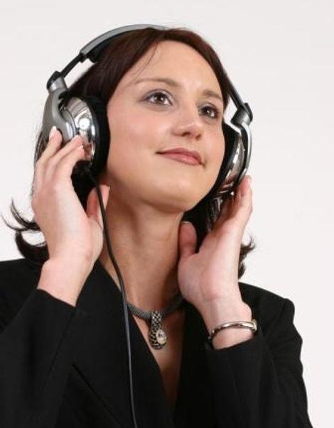 fotolia_120509, Lady with Headphones.jpg