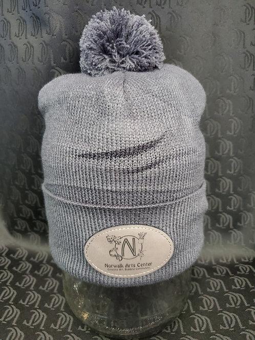 Knit Pom Pom Cap with faux leather NAC logo