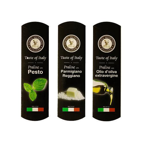 Degustazione di praline salate al pesto, parmigiano reggiano e olio di oliva extravergine.