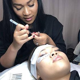 Gina Srey Master Lash Trainer showing lash application technique