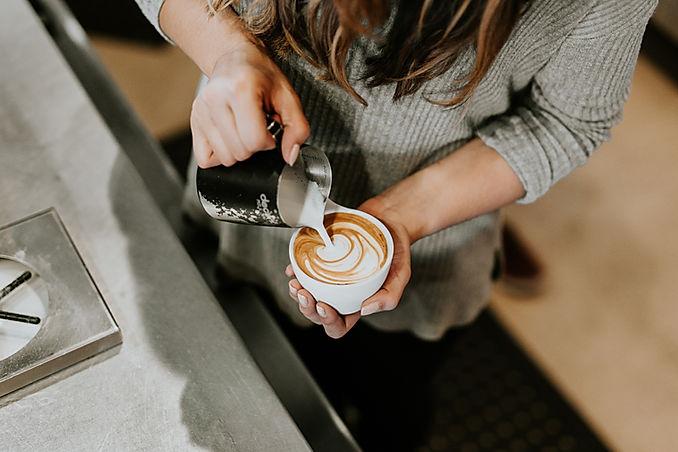 Lady pouring latte art