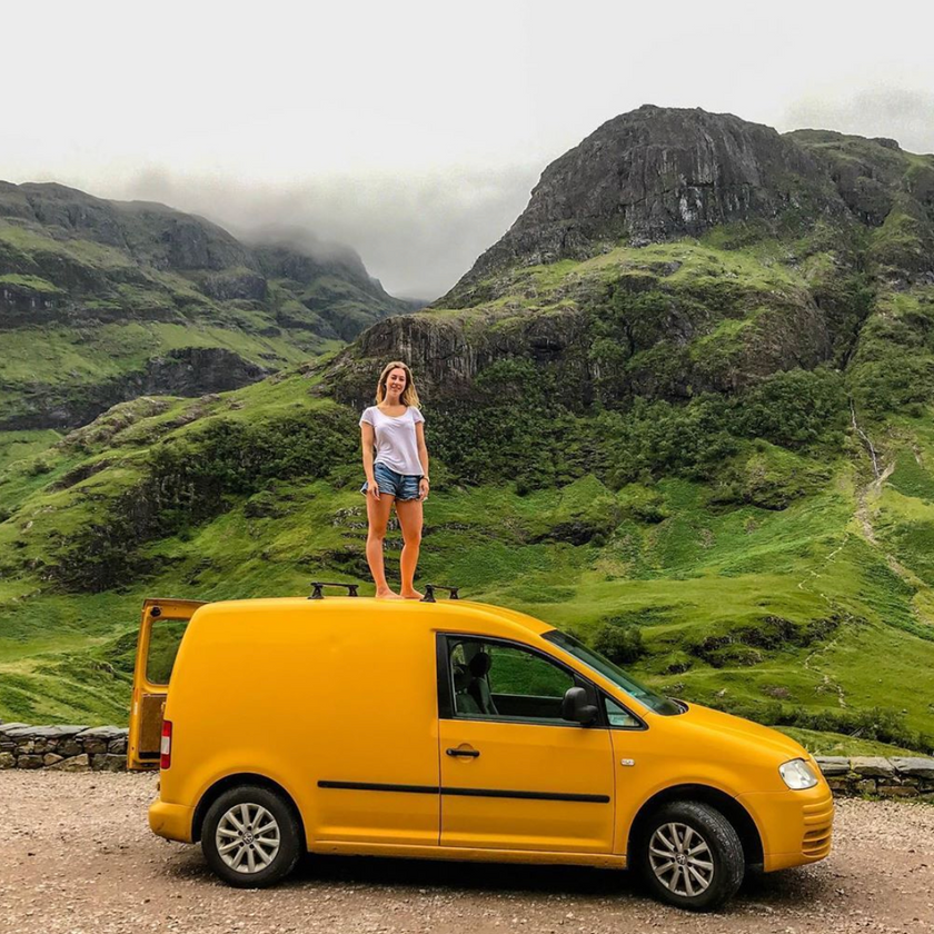 Yellow VW Caddy camper van conversion in the British mountains