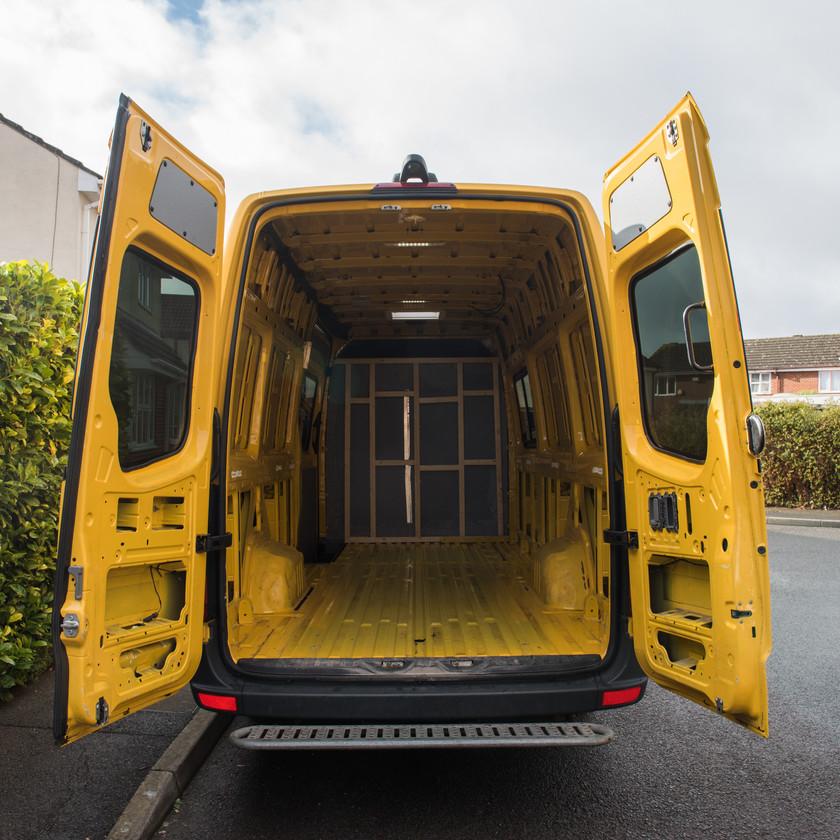 empty yellow Sprinter van conversion