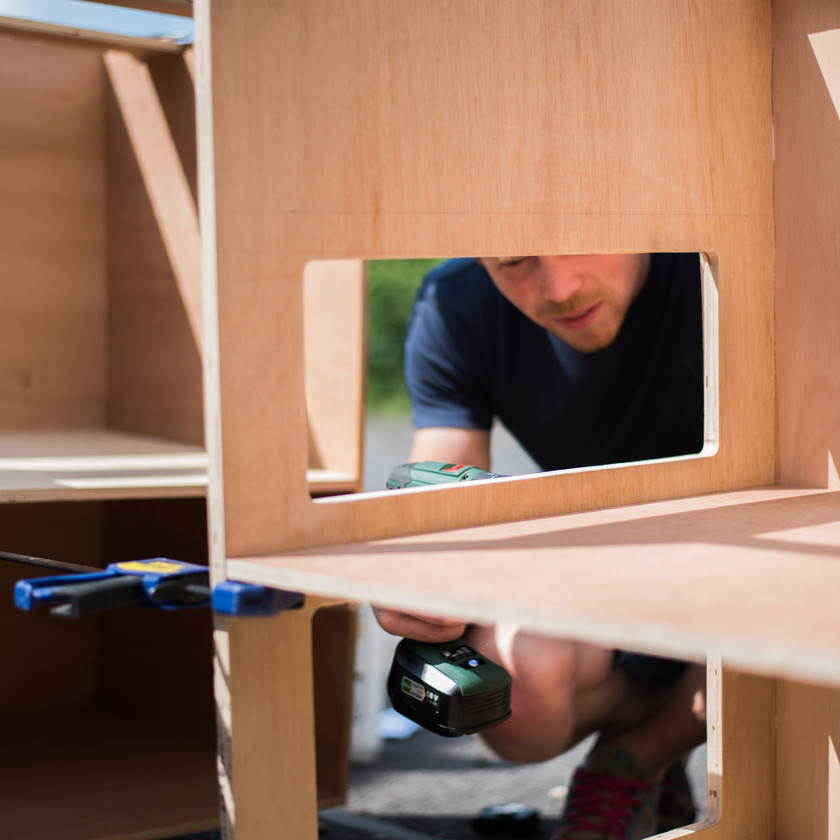 Man builds camper van kitchen cabinets out of ply